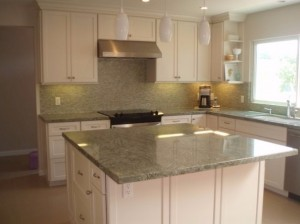 Custom white cabinet kitchen with large island by DM Building INC.