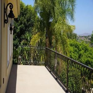 Side view exterior balcony wrought iron railing design custom home remdoel