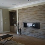 Textured wall surrounding modern fireplace Home remodel in San Diego County