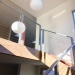 Modern new home build with tension staircase pendant lighting