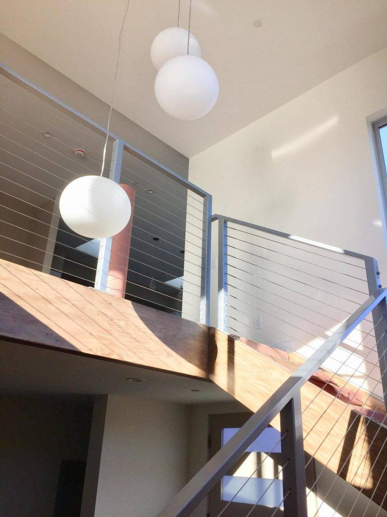 Modern New Home Build With Tension Staircase Pendant Lighting Dm Building Inc